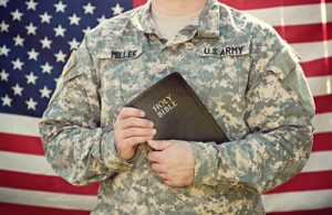 Soldier holding the bible