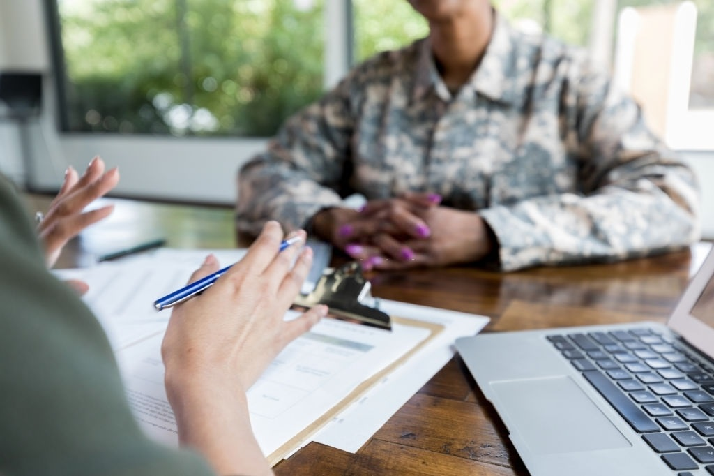 advisor talking with veteran about loans